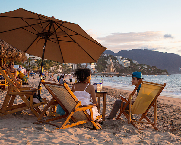 Family enjoying the beach in Puerto Vallarta